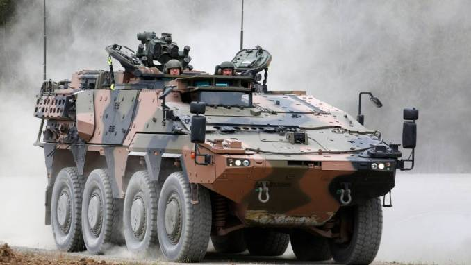 Chief of Army, Lieutenant General Rick Burr (left) is taken for a drive in an 8x8 Boxer Combat Reconnaissance Vehicle in Queensland. Picture: Department of Defence