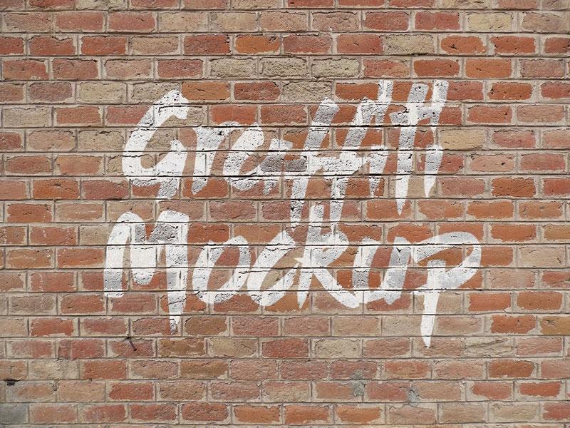 free logo graffiti brick wall mock up psd zee que designbolts