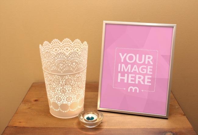 image frame on desk with candle mockup mediamodifier