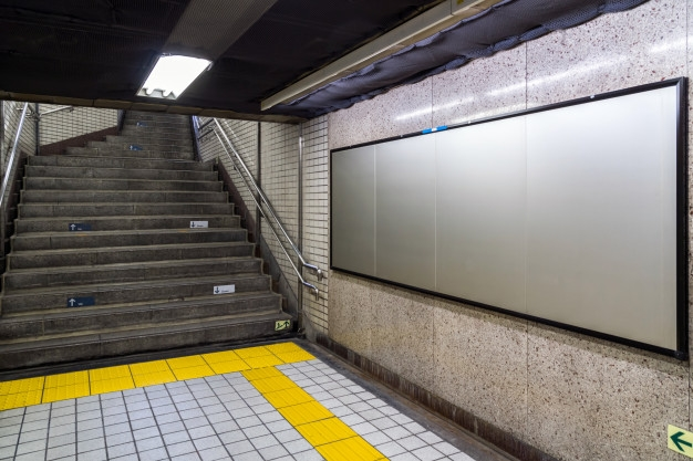 blank billboard located in underground hall or subway for