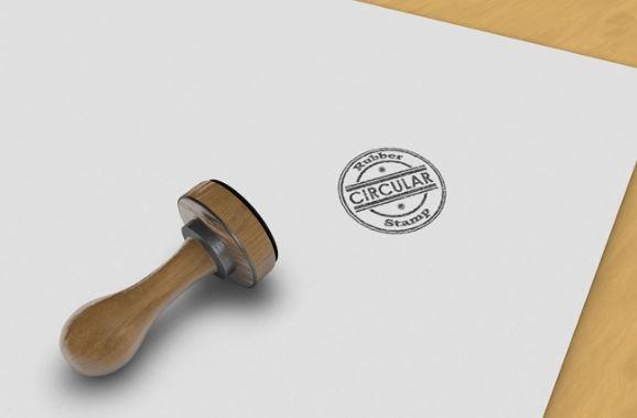 realistic circular rubber stamp on desk logo mockup template