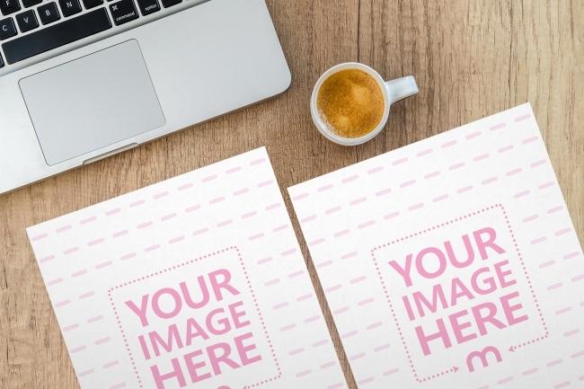 2 papers on office desk mockup mediamodifier