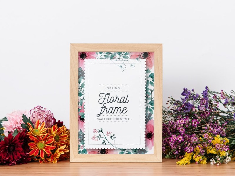 frame mockup between flowers free mockup