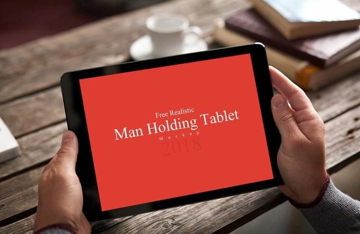 free man holding tablet mockup mockuptree