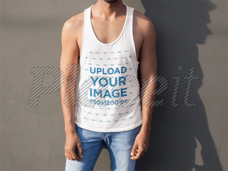 tank top mockup of a man in front of a concrete wall a7837