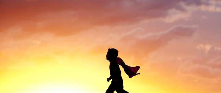 Silhouette of a Child with a Cape