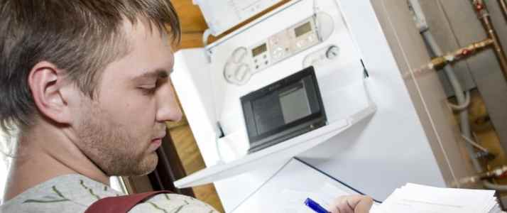 Person Writing a Report about a Boiler
