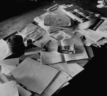 This is Einstein's desk. If a cluttered desk shows a pattern of genius, then I must be brilliant.