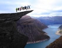 Jumping on the Trolltunga rock in Norway