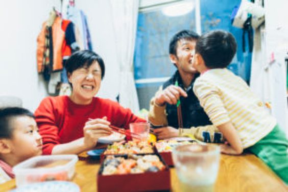 Family Enjoying Eating Together