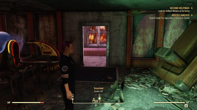 Inside destroyed diner, nearby enemy shown on bottom info bar.