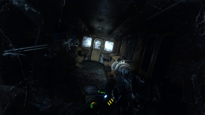 Player walking through dark destroyed train car