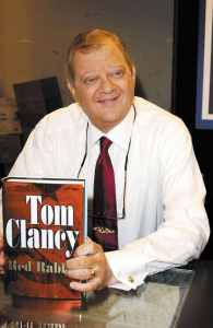 Tom-Clancy-poses-for-a-photograph-prior-to-signing-autographs-of-his-new-book-Red-Rabbit-2331188