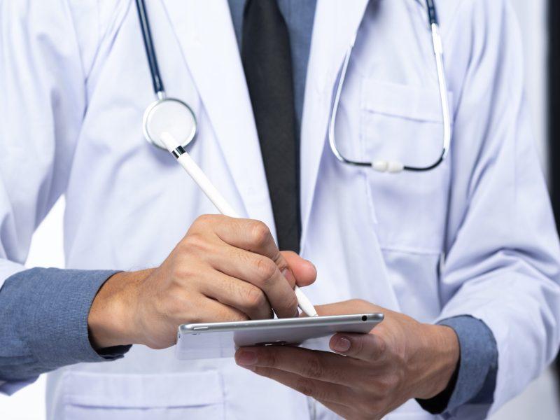 Doctor Wrting On The Tablet - Medical Cannabis - Cannabiz