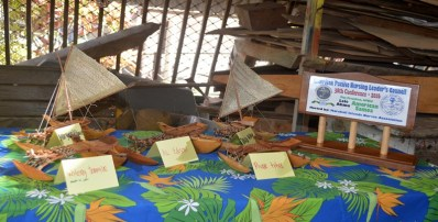 Some of the miniature canoes and a plaque made by the WAM trainees. Photo: Karen Earnshaw