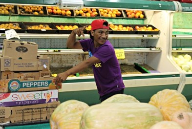 Witney Jormile helping in the produce department at K&K. Photo: Tolina Tomeing
