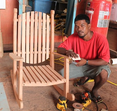 One of the newest creations from WAM trainees is Rocking Chairs like this one. Pictured Etri John. Photo: Suemina Bohanny