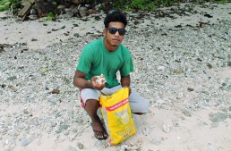 Trainee Lajwi Saimon collecting red rock for underground oven Photo: Sealand Laiden