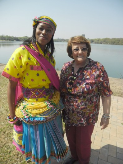 A Tsongo traditional lady with leader volunteer – Linda Burger