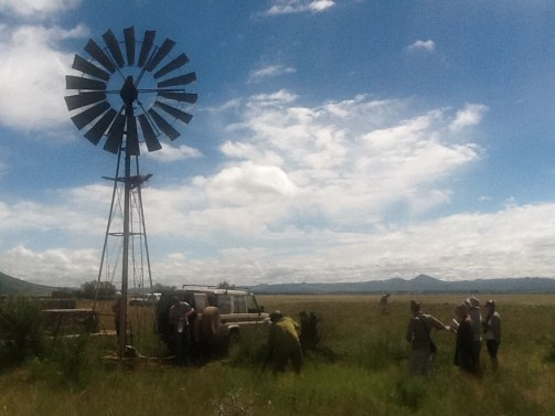 The first baseline water samples being taken from a borehole-wind-pump 14 km north of Cradock.