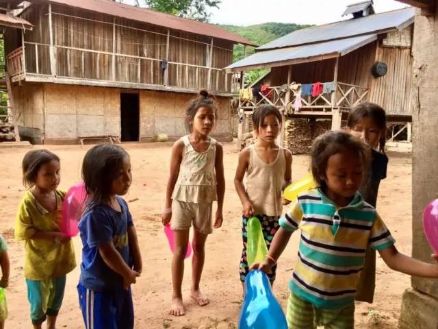 Kids with balloons in Nalan Neua Village in Nam Ha NPA, Laos