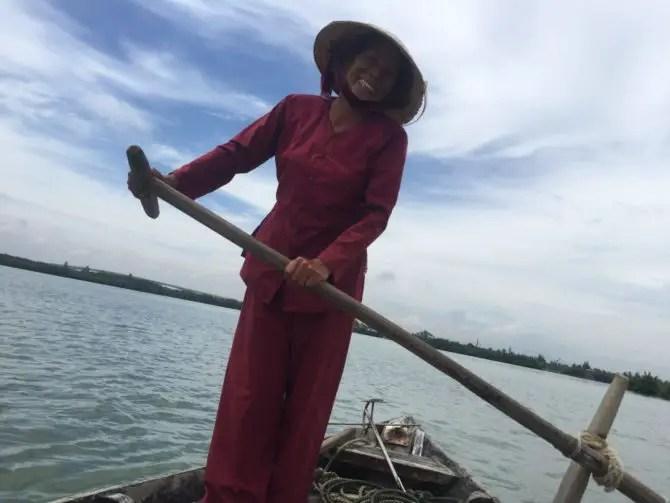 Vietnamese Fisherwomen Steering a Boat in Hoi An, Vietnam