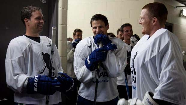 Dan Hamhuis, Kevin Bieksa and Cory Schneider of the Vancouver Canucks prior to the Bieksa's Buddies Charity Game