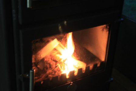 Photo of a Chilli Penguin wood burning stove in one of the safari tents