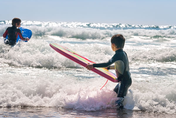 two boys surfing