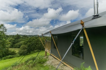 An image of the side of one of our luxury safari tents and the valley view beyond