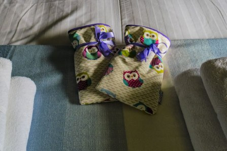 An image of hot water bottles on the king sized bed in Afon
