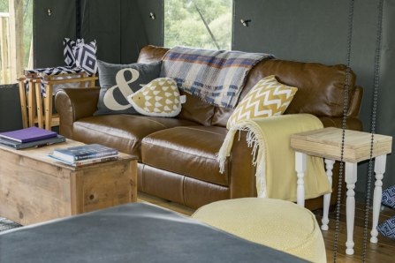 An image of the living area of Seren, showing the leather sofa and coffee table
