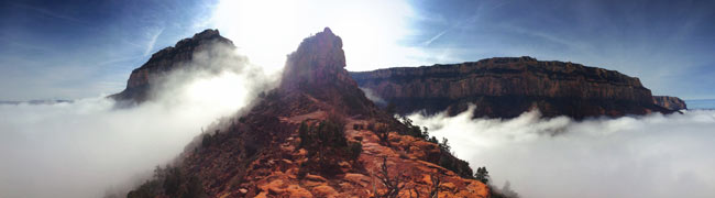 Yaki Point, Cedar Ridge, and Yavapai Point stand above a layer of clouds.