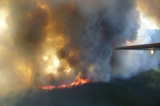 A forest fire burning near the BC/Yukon border Photo: TranBC, Creative Commons