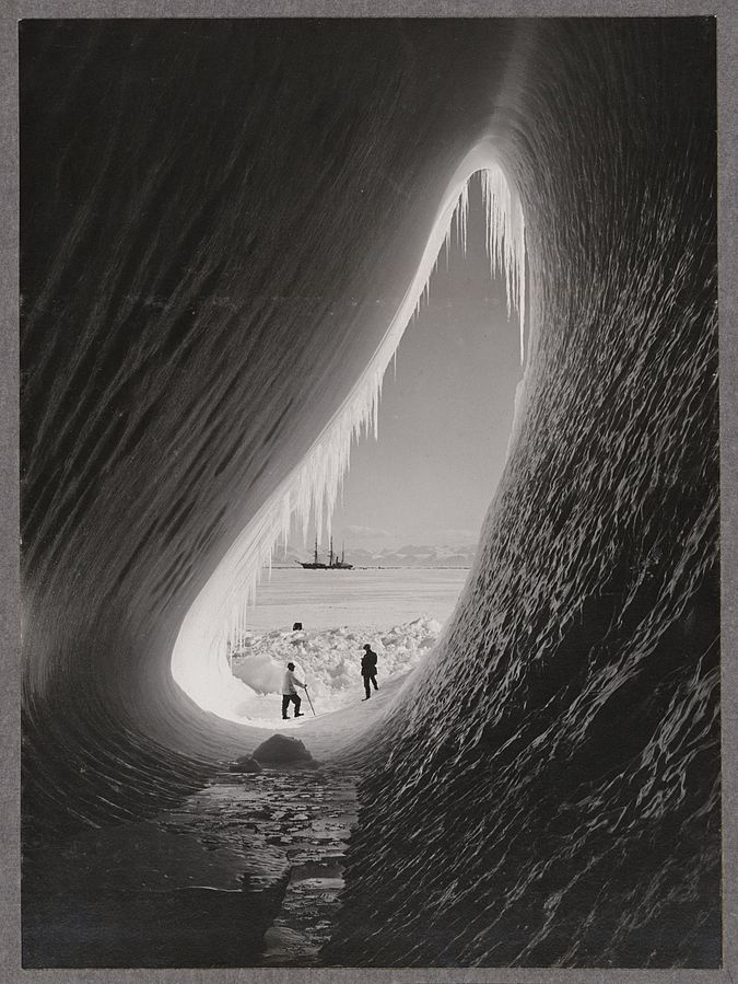 Grotto in an iceberg, photographed during the British Antarctic Expedition of 1911-1913, 5 Jan 1911. Photographer: Herbert Ponting, Alexander Turnbull Library