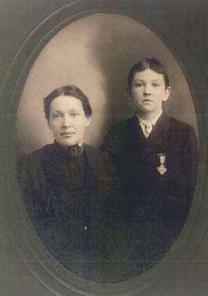 Mary Sawyer and her son Henry Washington Sawyer, 2nd wearing his father's Civil War medal. This photo was taken approximately nine years after the death of Henry Sawyer, Sr.