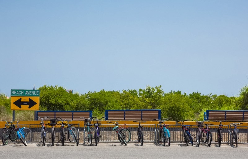 Bicycles lined up along Beach Avenue next to the promenade