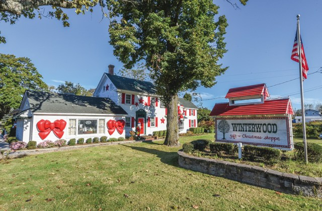 The white and red exterior of Winterwood Gift and Christmas Shoppe