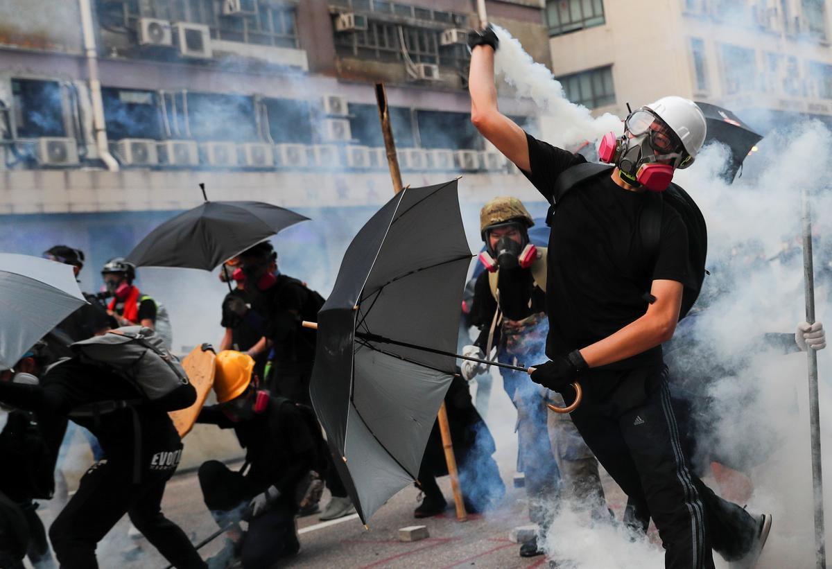 Hong Kong police use tear gas to counter protest petrol bombs