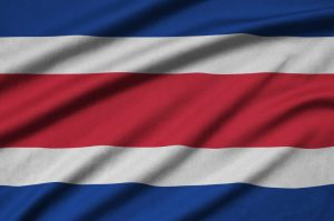 Costa Rica flag is depicted on a sports cloth fabric with many folds.