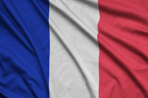 Flag of France is depicted on a sports cloth fabric with many folds.