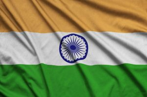 Flag of India is depicted on a sports cloth fabric with many folds.