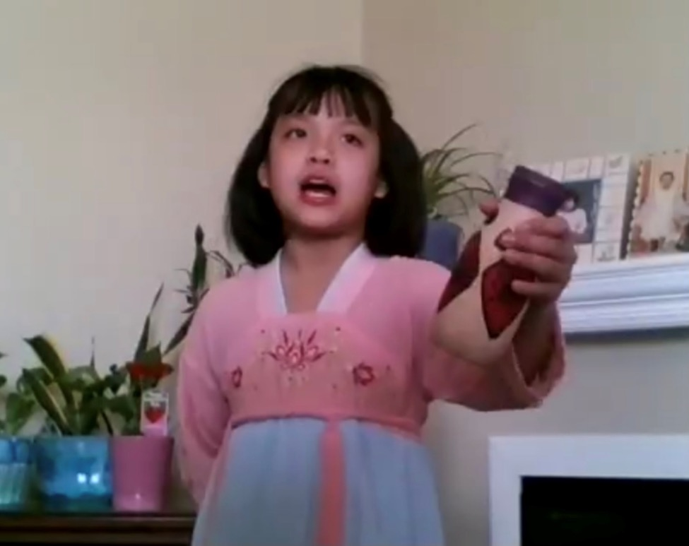 A child holding a phone  Description automatically generated with low confidence