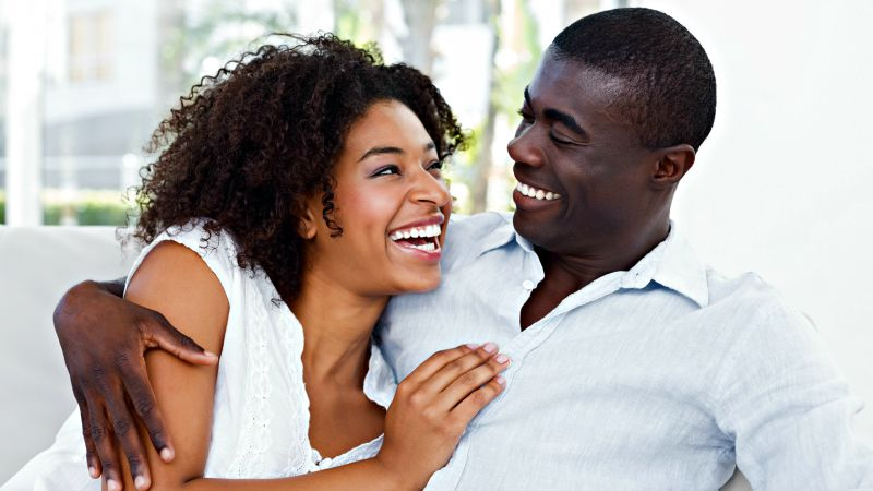 black couple smiling the