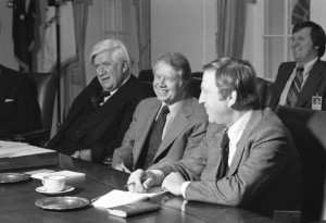 Both President Jimmy Carter (center) and Brademas (right) would lose in the Reagan wave of 1980. Speaker Tip O'Neill is seated on the left.
