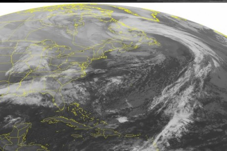 This NOAA satellite image taken Monday, Dec. 24, 2012 at 01:45 AM EST shows a low pressure system over eastern Canada with a cold front stretching across the central Atlantic Ocean. A low pressure system is moving across the Mississippi Valley into the southeastern United States with areas of rain and scattered thunderstorms. Father north, snow showers are seen over the Mid-West. (AP PHOTO/WEATHER UNDERGROUND)