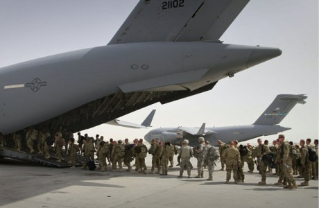 In this July 14, 2011, file photo, U.S. soldiers board a U.S. military plane, as they leave Afghanistan, at the U.S. base in Bagram north of Kabul, Afghanistan. The Obama administration gave the first explicit signal Tuesday, Jan. 8, 2013, that it might leave no troops in Afghanistan after December 2014, an option that defies the Pentagon's view that thousands of troops may be needed to keep a lid on al-Qaida and to strengthen Afghan forces.(AP Photo/Musadeq Sadeq, File)