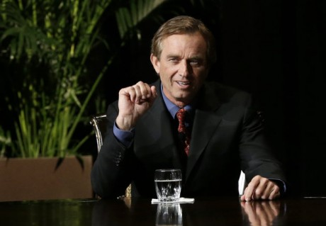 Robert F. Kennedy Jr., left, makes comments during the opening minutes of a interview with journalist Charlie Rose in front of a full audience at the AT&T Performing Arts Center Friday, Jan. 11, 2013, in Dallas, Texas. The Kennedys are in Dallas as a year of observances begins for the 50th anniversary of President John F. Kennedy's assassination.(AP Photo/Tony Gutierrez)