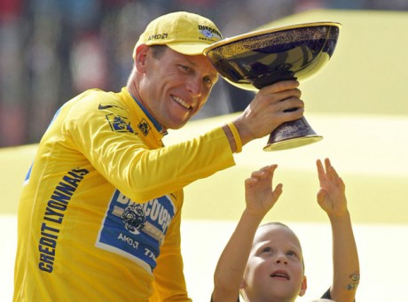 Luke Armstrong, rear right, tries to touch the winner's trophy held by his father, Lance Armstrong, after Armstrong won his seventh straight Tour de France cycling race, in Paris. During the second part Friday, Jan. 18, 2013, of Oprah Winfrey's interview with Armstrong, Armstrong talked about talking with Luke after his son had defended him concerning doping allegations. (AP Photo/Peter Dejong, File)