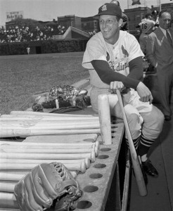In this May 13, 1958 file photo, Stan Musial, St. Louis Cardinal all-time great baseball player, poses in dugout prior a baseball game against the Chicago Cubs in Chicago. Musial made his 3,000th career hit in the game. Musial, one of baseball's greatest hitters and a Hall of Famer with the Cardinals for more than two decades, died Saturday, Jan. 19, 2013, the team announced. He was 92. (AP Photo/File)